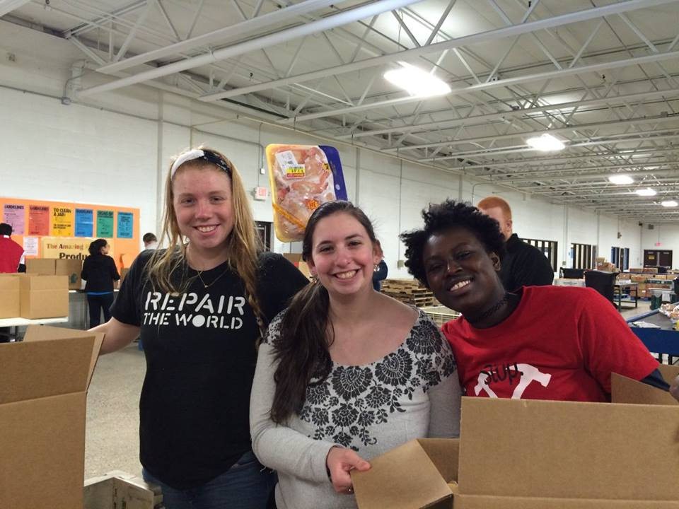 Students volunteer in food bank during a service trip to Detroit and Flint, Mich.