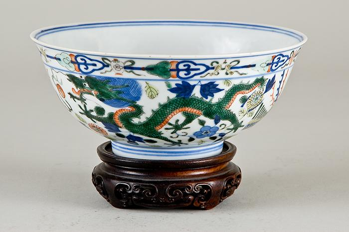 Photograph of a Chinese bowl with dragons painted on it.