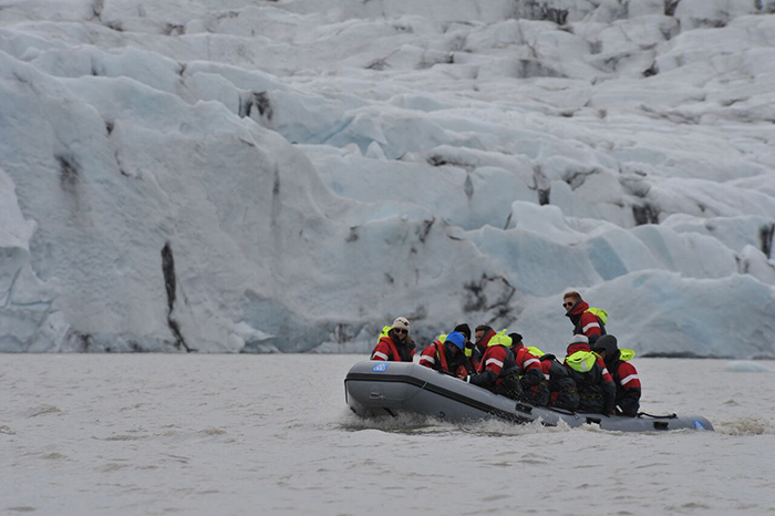 Alumni travel on a glacier lake.