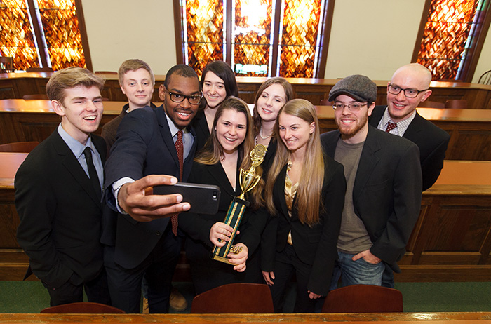 Members of the winning mock-trial team commemorate the moment.