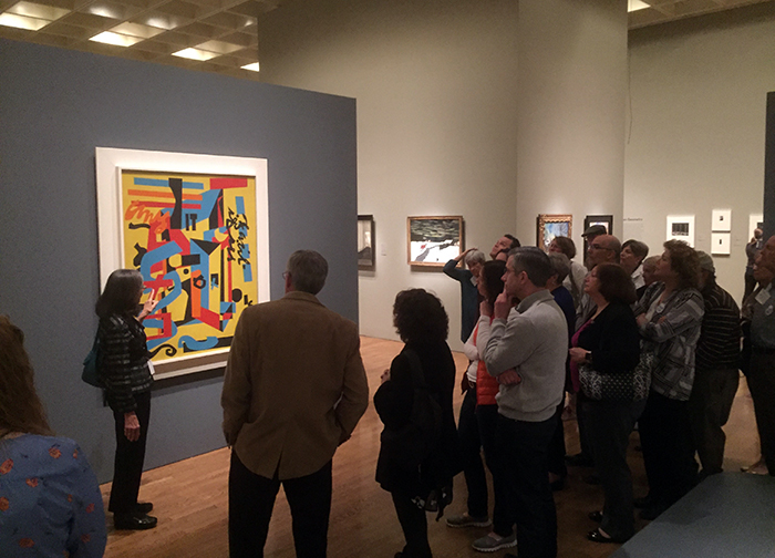 Alumni and friends of the college learn what to look for in paintings during a private tour of the Philadelphia Museum of Art.teaches alumni and friends of the college what to look for in paintings at the Philadelphia Museum of Art.