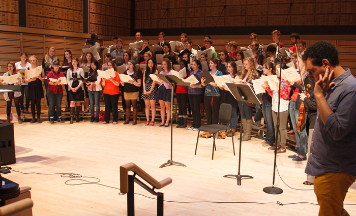 In 2013, composer Mohammed Fairouz (far right) worked with student vocalists who were preparing to perform his 2012 oratorio.