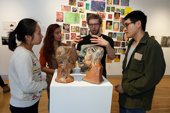 Senior studio art majors discussed their works in progress during last week's reception. The works draw from many different disciplines, including meteorology, music, psychology, sociology and neuroscience. Photo by Carl Socolow '77.