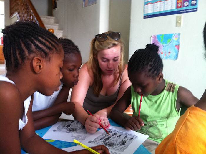 Molly DiLeonardi '15 and a few of her young pupils. Photo by Dominique Pierre, program director of Children of Haiti Project.