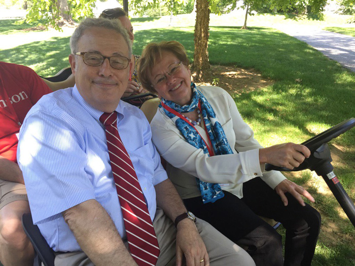 Interim President Neil Weissman and President-elect Margee Ensign pose for a shot in one of the many golf carts staff used to get around campus during Alumni Weekend. Photo by Carl Socolow '77.