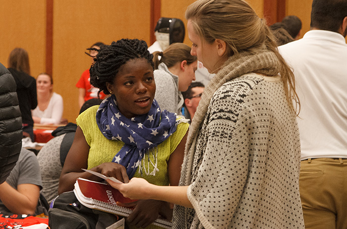 Students find others with like interests at the spring activities fair. Photo by Carl Socolow '77.