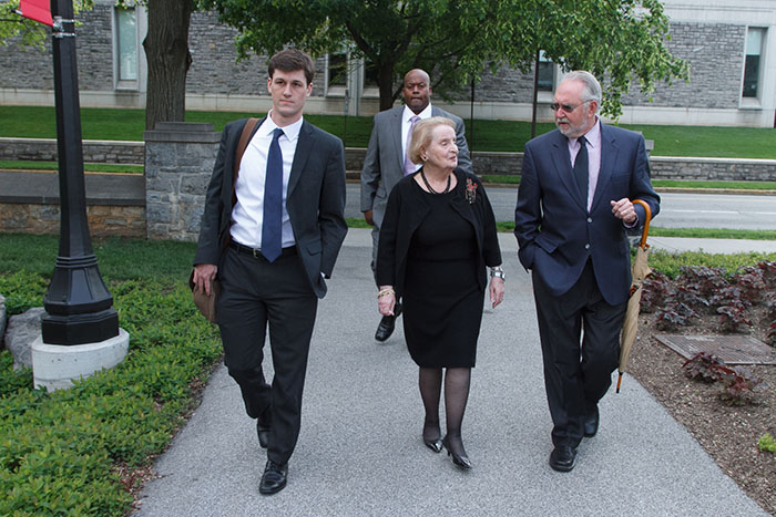 Chris Roberts (left) walks with Secretary Albright, Professor Stuart and Officer Mann
