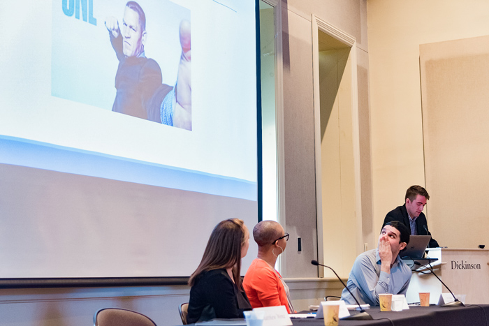 Matthew Wenz '17 presents his research on the construction of masculinity in WWE performances. Photo by Wes Lickus '17.