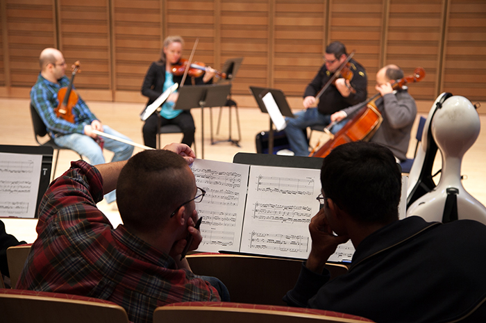 Student composers look on as the Amernet Quartet performs their works as part of their on-campus residency. Photo by Carl Socolow '77.