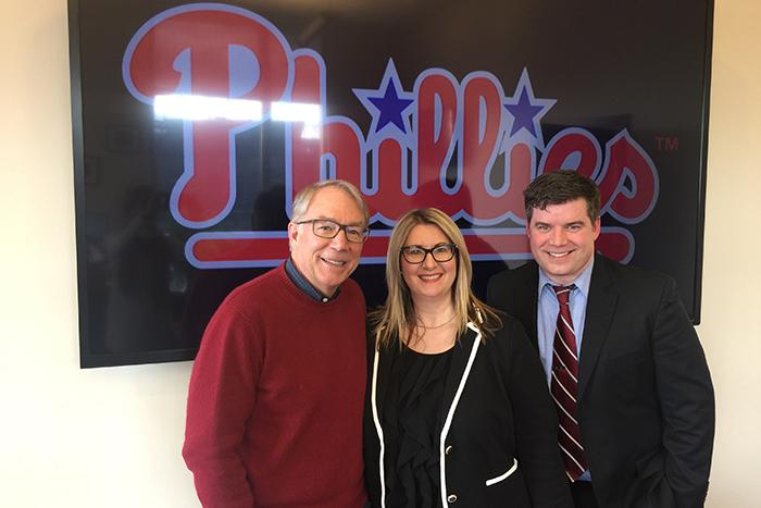 Andy MacPhail '76 with 'The Good' producers Christine Baksi and Craig Layne