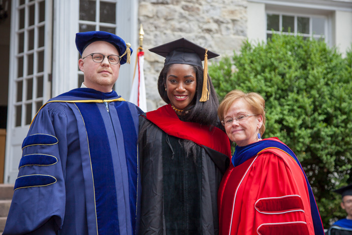 Karen Attiah, the Washington Post's global opinions editor, poses with Ensign and 