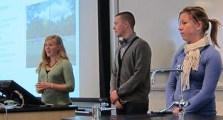 Photograph of students presenting their research