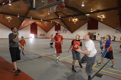 Picture of boys playing basektball in Kline center