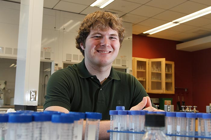 Aaron Brumbaugh '14 in the lab