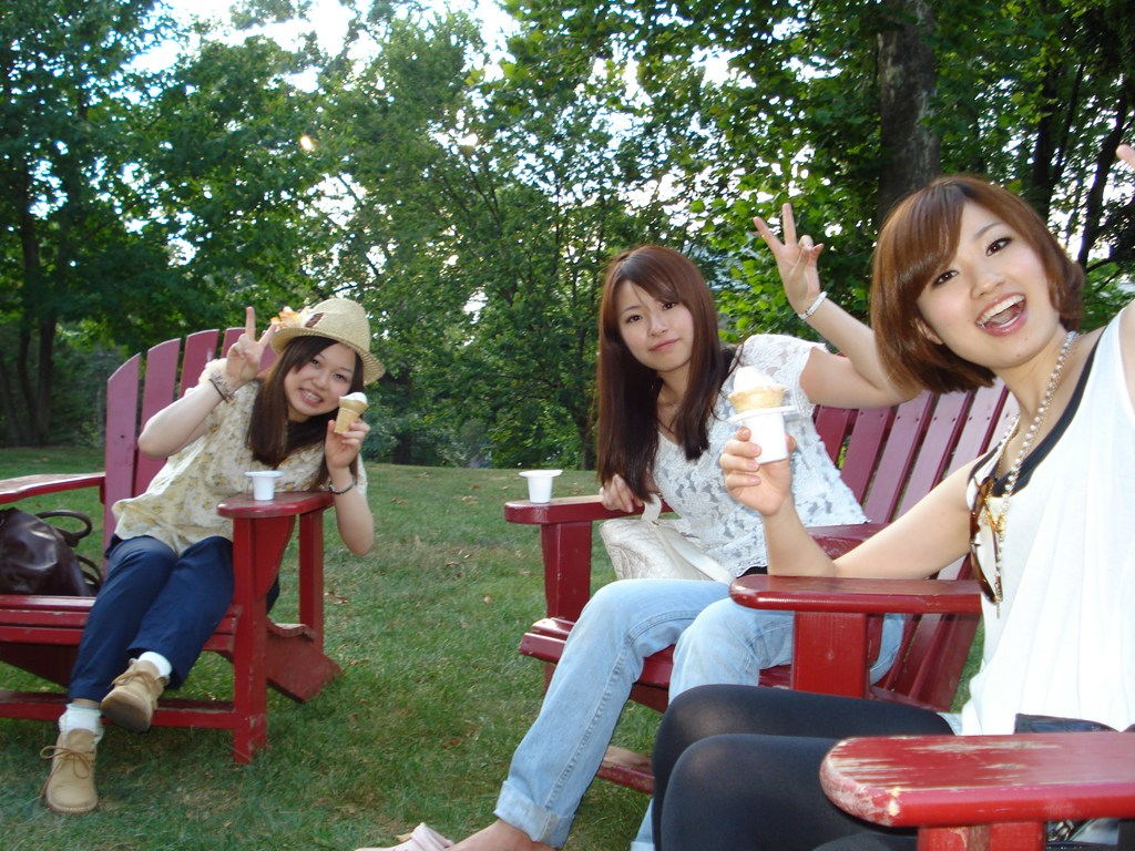 Nanzan University (Japan) summer program at Dickinson - students enjoying local ice cream in the red Dickinson chairs.