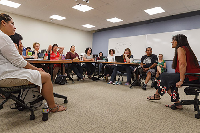 Participants attended a workshop led by Lakota/Kiowa Apache storyteller, cultural educator, author and recording artist Dovie Thomason to learn how to utilize the CISDRC and storytelling in their teachings. Photo courtesy of Carl Sander Socolow '77.