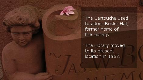 Picture of stone cartouche, with text: The Cartouche used to adorn Bosler Hall, former home of the library. The library moved to its current home in 1967.