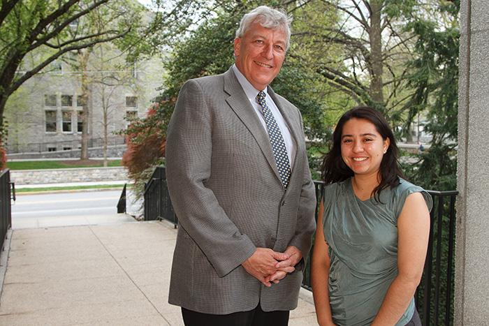 Jim Chambers '78 poses with the recipient of his scholarship, Yessenia Tostado '16.