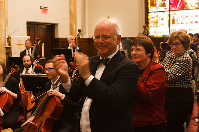 Professor Emeritus Truman Bullard delivers a standing ovation at the close of the April 27 concert. Photo by Carl Socolow '77.
