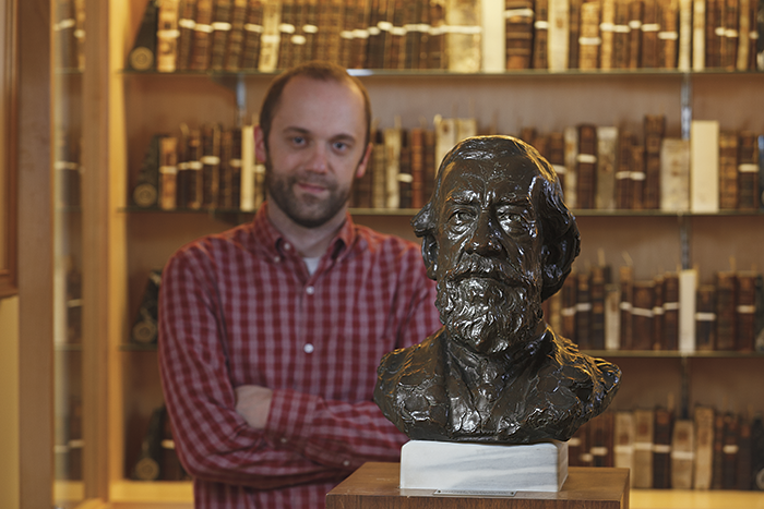 Don Sailer, library digital projects manager, with Dickinson's bronze bust of Moncure Conway, class of 1849.