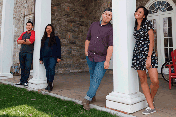 Edgar Estrada '18, Janel Pineda '18, Armando Moreno '20 and Jennifer Zapata '17 in front of the Social Justice House.