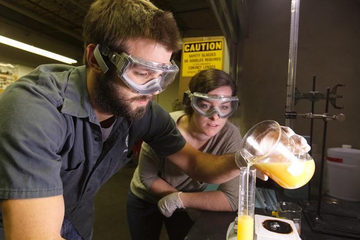 Students convert waste vegetable oil to biodiesel fuel.