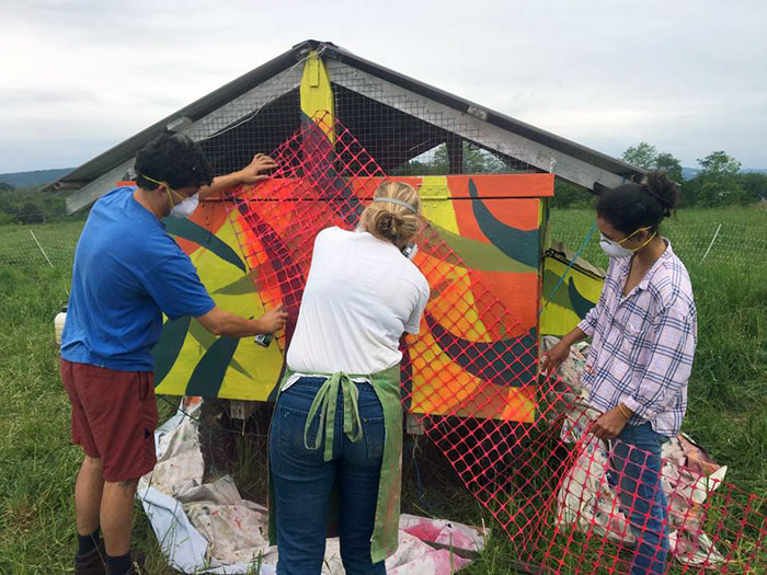 Student paint the chicken coop
