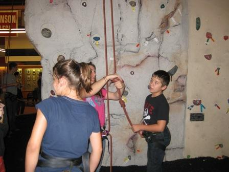 DreamCatcher students participate in homework study group after school and have fun climbing the rock wall.