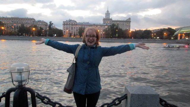 Danielle Collette stands in front of the river in Moscow.