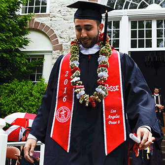 Andy Vargas '16 steps forward during Commencement