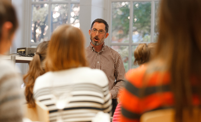 Environmental-science professor Greg Howard delivers a FaculTea lecture in the Biblio Cafe.