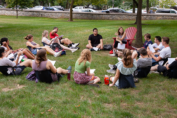Students in a first-year seminar take advantage of a warm summery day during Orientation Week. Photo by Carl Socolow '77.