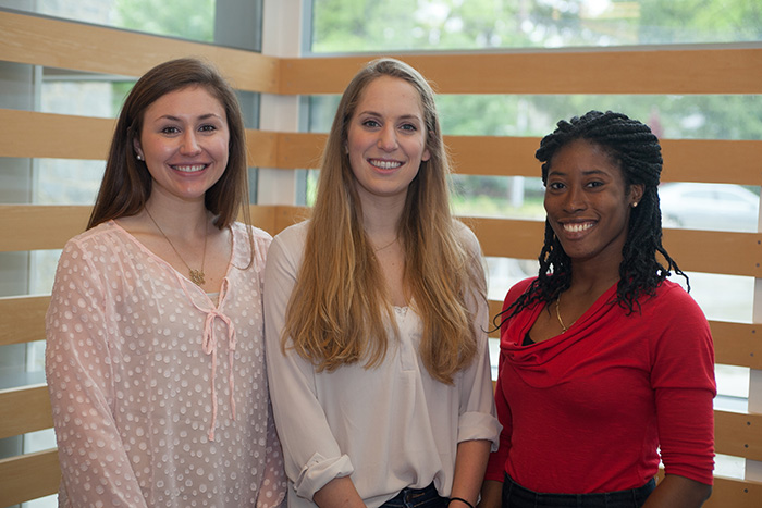 Juniors (from left): Emma Batchelder, Jessica Hampton and Aphnie Germain. Not pictured: Courtney Capella, who graduated in February. Photo by Carl Socolow '77.