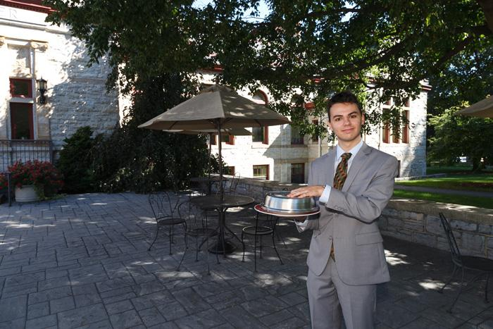 Political-science major James Cerasia '18, who worked on the business plan for the new GATHER pop-up, holds a tempting surprise. Cerasia will be among the student volunteers who will help serve diners during the September event. Photo by Carl Socolow '77.