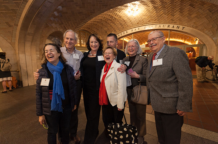 Alumni pose with President Margee Ensign at the Grand Central Terminal in NYC. Photo by Carl Socolow '77.