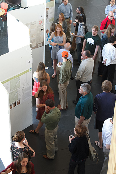 Students present GIS projects during the annual symposium. Photo by Carl Socolow '77.