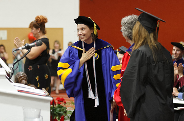 Wlodarski responds with surprise and gratitude during the 2015 Commencement ceremony. Photo by Carl Socolow '77.