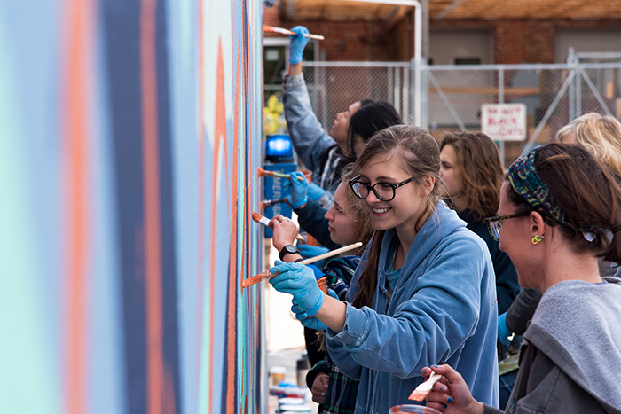 students create a mural at Goodyear Studios, on the Dickinson campus.