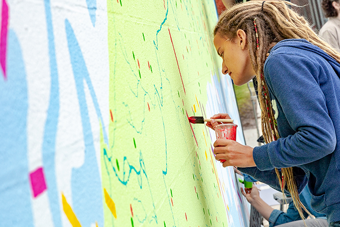 Larissa Babicz '20, a biology major, was a student-assistant for the mural project. Photo by Carl Socolow '77.