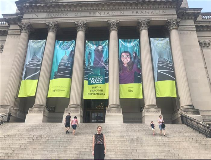 Molly Gorelick '19 stands in front of The Franklin Institute as the Social Media Intern.