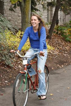 Student Morgan Abel riding one of Dickinson's Green Bikes.