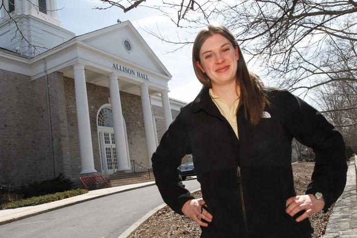 Allison Hall poses in front of Allison Hall