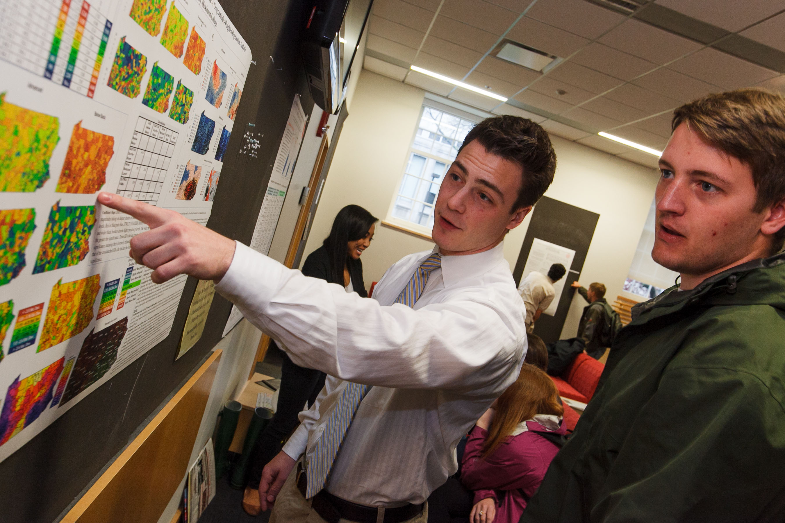 Student and professor at a poster session
