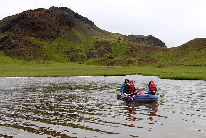 Dickinson College researchers travel in a small boat on an Icelandic lake.