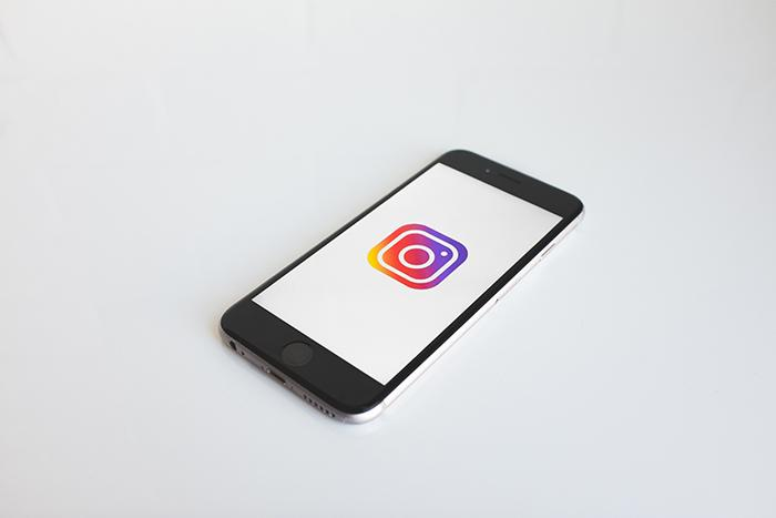 An iPhone with the Instagram logo.