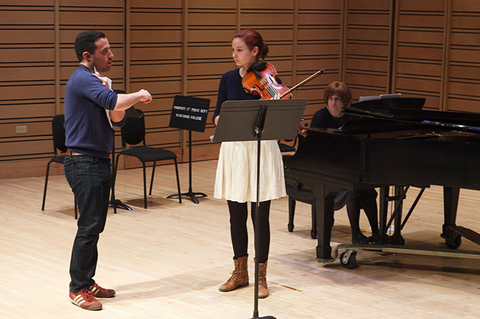 Music major Elizabeth Johnsen '17 gets personalized tips during a March 27 master class conducted by JACK Quartet, one of nearly a dozen artists-in-residence to visit Dickinson this year.