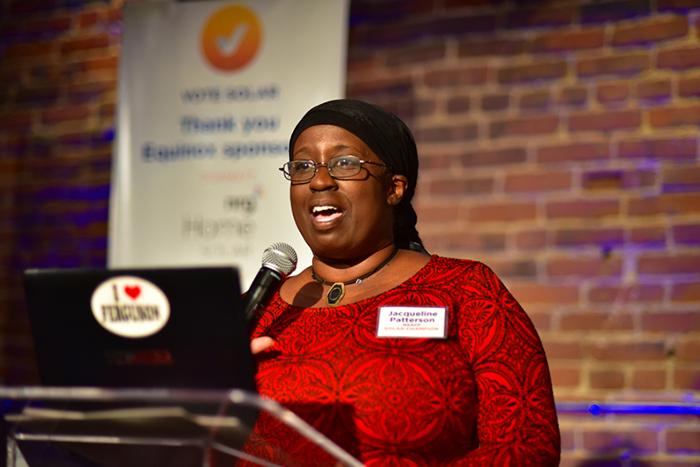 Photo of Jacqueline Patterson speaking at a podium.