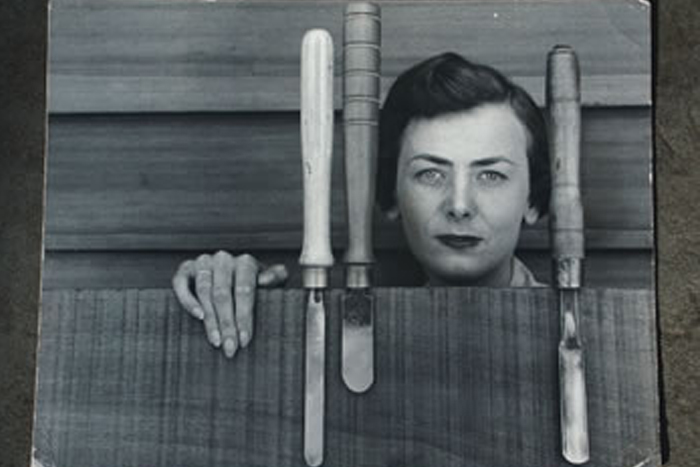 In 1956, Joyce Rinehart Anderson '45 is depicted with some woodworking tools.