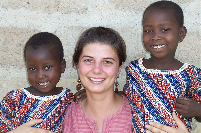 Maggie Murphy in Togo with two young neighbors.