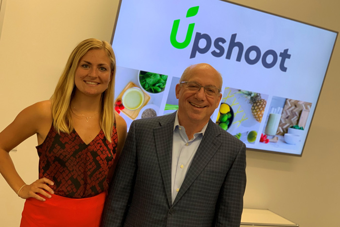 Kirsten Brodeen '20 poses with Mark '71 Lehman '71,  at Upshoot LLC, where she was an entrepreneurship intern this summer.